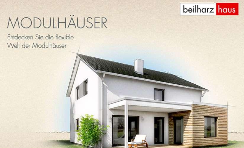 """Das neue Modulhaus """"PURE"""" bietet ein offenes Wohnkonzept mit geradlinigem Treppenaufgang."""