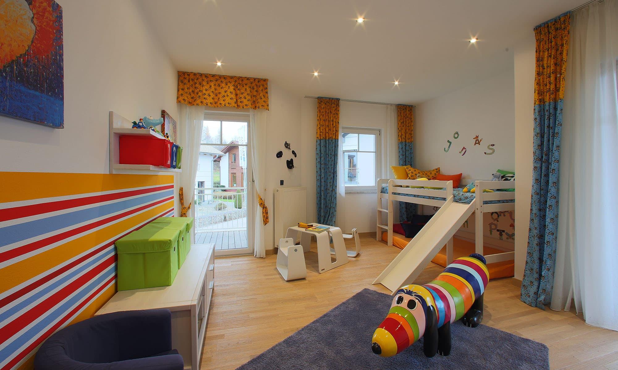 Das liebevoll und farblich abgestimmte Kinderzimmer des Musterhauses Living 148 von ELK überzeugt auch den kritischsten Nachwuchs.