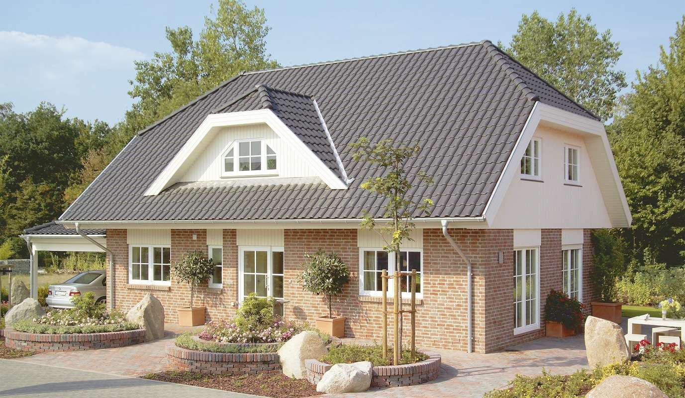"""<p><strong>Das 1Liter-Haus! """"Glücksburg"""" mit einer integrierten, offenen Garage</strong></p>"""
