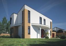 Musterhaus mit Falchdach und rundem Hauseingang